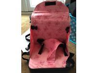 Fold up pink travel seat