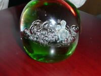 Glass paperweight - clear glass and green bubble
