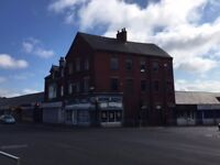 Large commercial building with planning permission for 12 Apartments