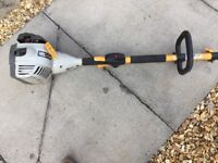 Ryobi Strimmer with Hedge trimmer attachment. Petrol strimmer with hedgetrimmer.
