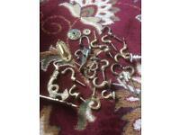 Brass coat hooks or curtain tie backs