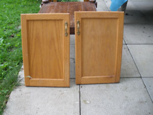 Pair of oak finish cabinet doors with hinges