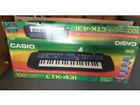 Casio electronic keyboard with stand