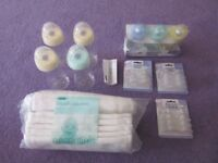 Brand new baby bottles and muslin squares