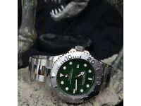 Silver/green YachtMaster Rolex. Complete with Box, Bag & Paperwork.