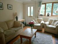 Cream sofa and two armchairs