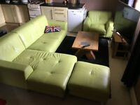 DFS leather three seater sofa suite with chaise lounge, armchair and footstool all in pale green