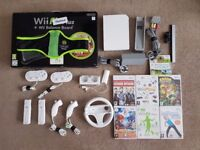 Nintendo Wii with 7 games, 2 controllers and extras!