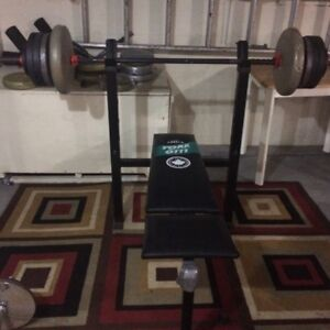Bench press and some plastic weight and iron
