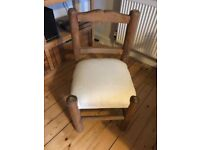 Wooden chair with cushioned seating