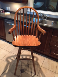 Two Oak bar height stools for sale