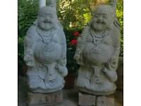 A pair of stone Buddha garden statue