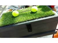 """Unique wooden tool box with tennis ball """"dumbell"""" on estro turf detail"""