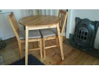 Pine Dining table +2 chairs and seat pads x2
