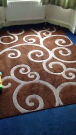 Brown 90x63 inch rug with cream swirl pattern