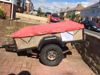 Car trailer 3.5 x 5.5 ft approx. Handy for tip runs and camping. Trailer board and cover, average .