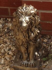 A pair of solid bronze effect lions