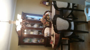 Beautiful dining room table and China cabinet for sale .