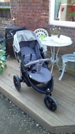 Hauck travel system with moses basket and rocking stand with vibrating baby chair.