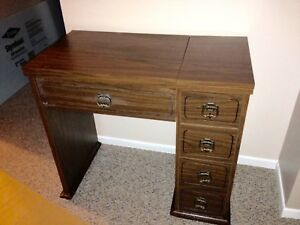 Sewing table with accessories. Excellent condition. $ 120 OBO