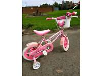 """Pink bike 12"""" with stabilizers. Used, good condition"""
