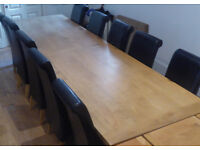 12 seater long solid oak dining table and chairs