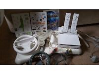 NINTENDO WII AND GAMES AND WII FIT AND BOARD