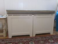Two laundry boxes with single sitting cushion