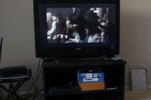 """42"""" SANYO Tv with black stand."""