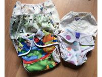 Seven good condition nappy wraps