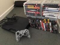 PlayStation 3 Slim w/wireless controller + 35 games