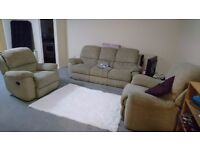 Cream sofas with reclining seats