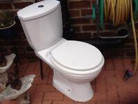 White toilet with cistern