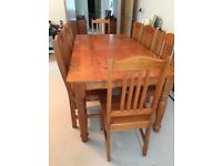 Eight seat dining room table with sideboard. Oregon pine - excellent condition.