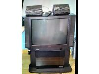 Toshiba 3357DB old style TV with surround sound, stand, freeview box, remotes, instruction manual.