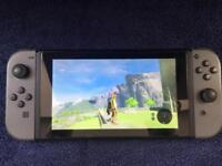 Nintendo switch and 2 games. Immaculate condition, free local delivery