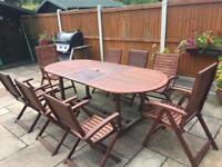 Extendible wooden garden table and 8 chairs