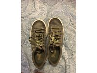 Limited edition olive coloured size 5 Puma platform trainers