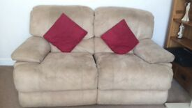 2xtwo seater reclining sofas. Beige faux suede good condition. Backs come off for transportation