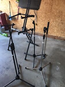 double tiered keyboard stand and various mic stands