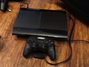 PS3 slim CECH- 4001 B, 4 games