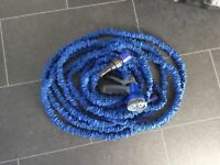 25 FOOT (BEFORE EXPANDING) EXPANDABLE X HOSE BRAND NEW- COMES WITH SPRAY GUN ADAPTOR 30