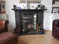 Cast iron Victorian fireplace with inset tiles and surround