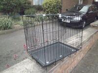 some black large dog cages