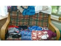 Large bundle of 181 items of clothing and shoes size 18 to 24.