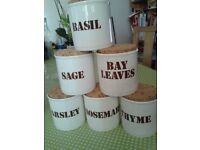 12 ironstone pottery jars for spice and herb storage.