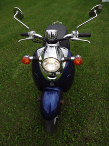 Scooter with helmet for sale