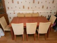 Cherry wood table with 8 chairs and matching sideboard
