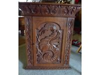Vintage really stunning hand carved corner cabinet with carved Chinese? dragon and original key
