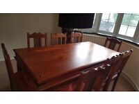 Stunning Designer 8 seater dining table solid wood with 8 fret back chairs